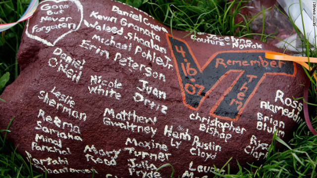 The names of the victims on a rock at the campus