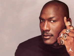 Michael Jordan with his Championship Rings